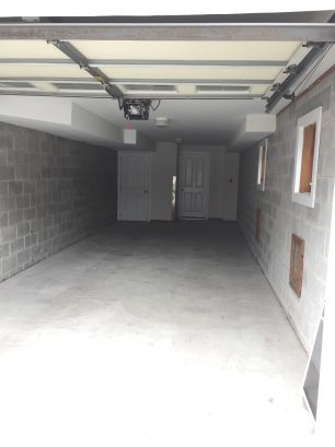 Large garage with goom for 1 car plus all of your beach equipment.  A second car can also park in the driveway.