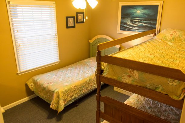 Wooden bunkbeds and single bed