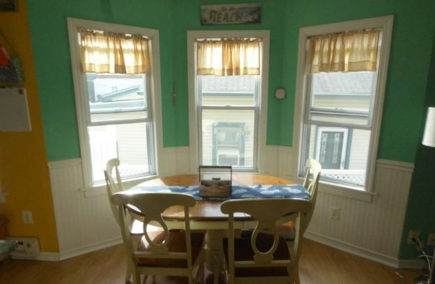 Table seats six (bench seat on the back). We have a card table and four additional chairs as well as four stools at the counter for more seating.