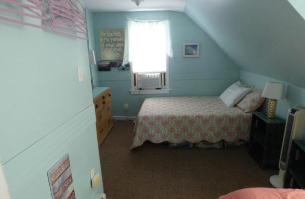 Bedroom 3 - double bed and single bed, window AC, tower fan, dresser, wall clothes hanger. Walk through this bedroom to get to bedroom 4.