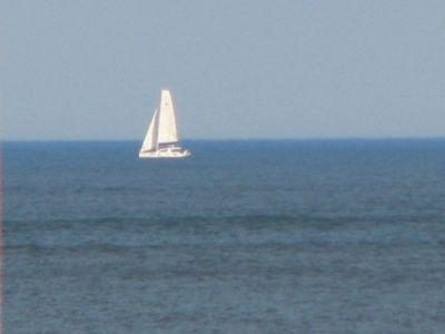 Early morning sailboat heading out. Viewed from Main Deck. What a way to start the day! Sunny Deck, Coffee, & Mallons!