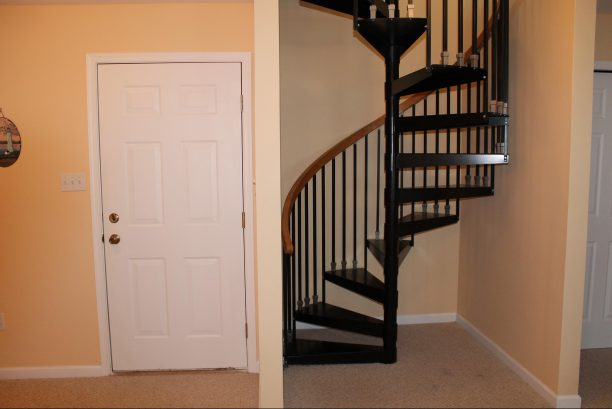 Spiral staircase from first floor up to second floor.