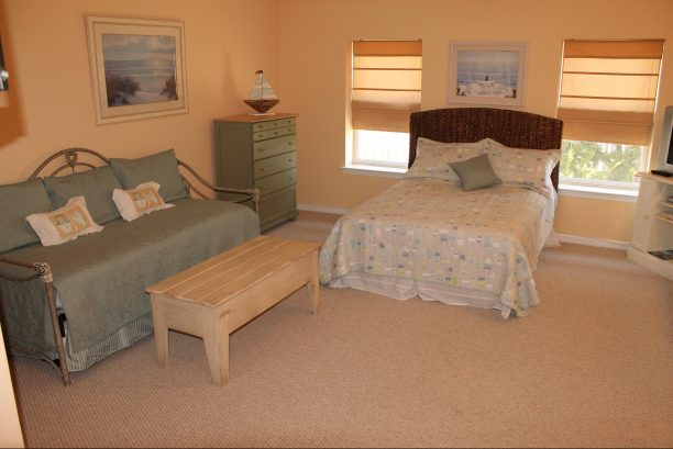 First floor bonus/bedroom with double bed and twin day bed with trundle.