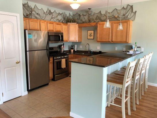 Kitchen with breakfast bar stool seating