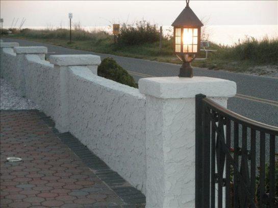 Seawall at driveway gates.