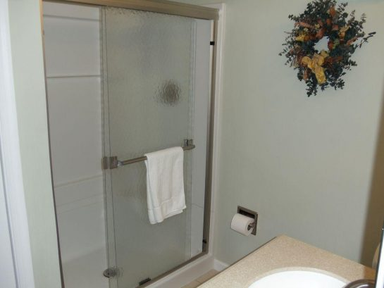 Master Bedroom Bath with Shower, Toilet, Sink and Large Closet