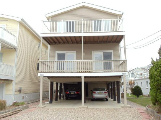 Covered Carport & Offstreet Parking for 2 Cars. You are just 3 houses from beach
