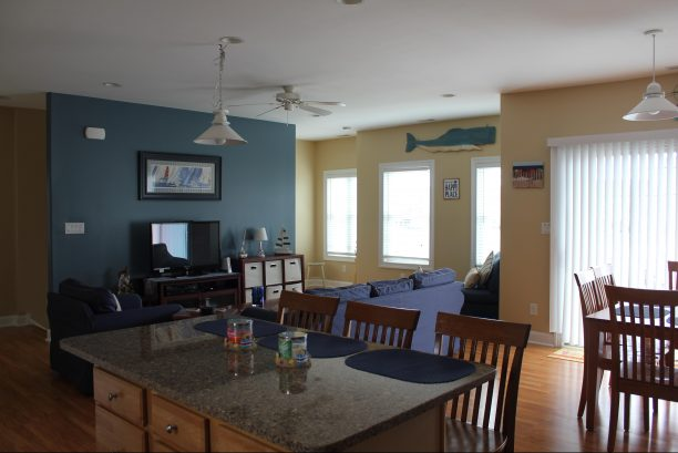 Living room & large center island w/seating for 3.  Lots of natural light.
