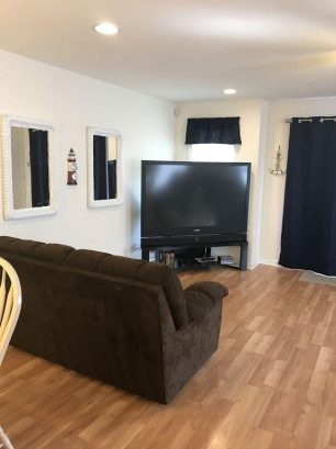 "Living Room with 67"" Big Screen TV - DVD - 100 Channel Cable"