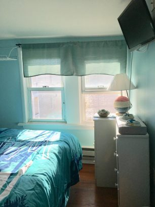 Bedroom with full bed has incredible ocean views