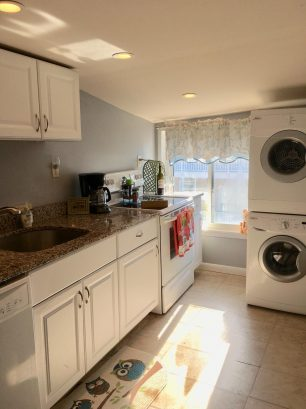 Renovated kitchen with granite counter tops and ocean views!