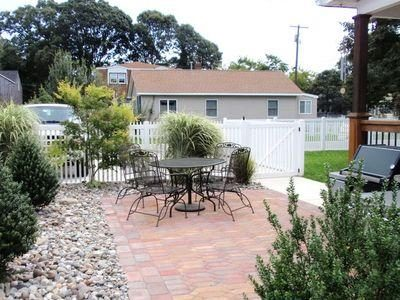 Side yard paver patio with weber grill