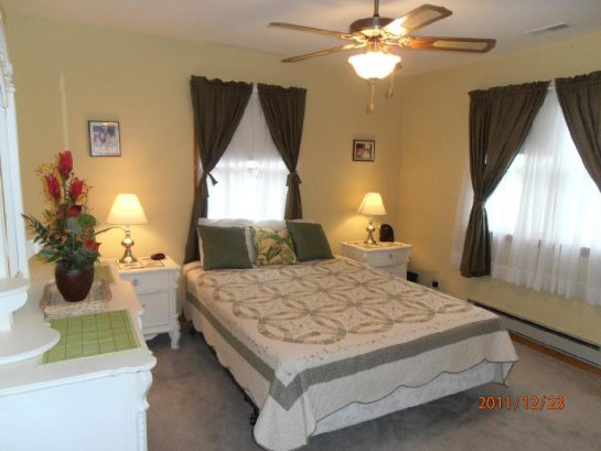 Master Bedroom has queen bed and ceiling fan
