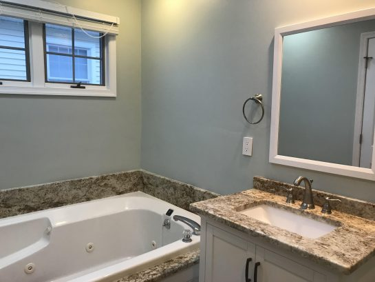 Master Bathroom with Custom Granite Counter and Tub Surround, Plus Shower with tile/Kohler base.