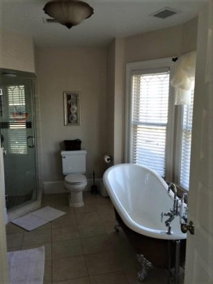 Master Bath with walk in shower and claw foot tub