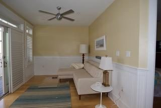 1ST FLOOR FAMILY ROOM WITH VIEW OF THE POOL