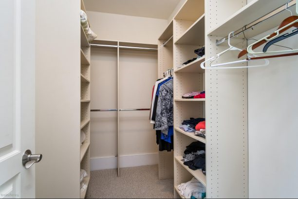 ONE OF THE MASTER BEDROOM WALK IN CLOSETS