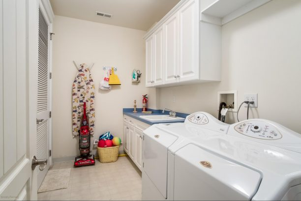 FULLY EQUIPPED LAUNDRY ROOM FEATURING MATAG APPLIANCES