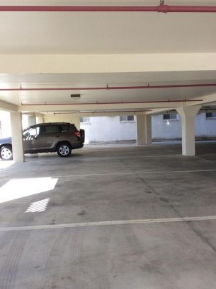 UNDER COVER PARKING FOR 2 VEHICLES ACROSS FROM ELEVATOR