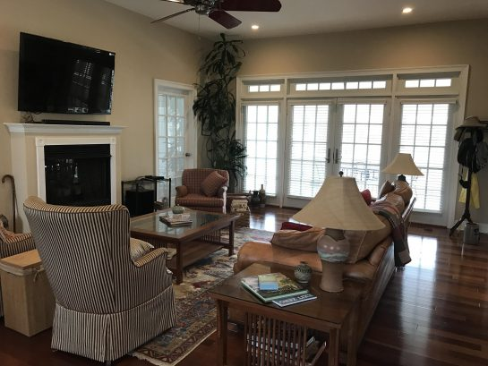 """Comfortable living area with 55"""" flatscreen tv, wi-fi and cable."""
