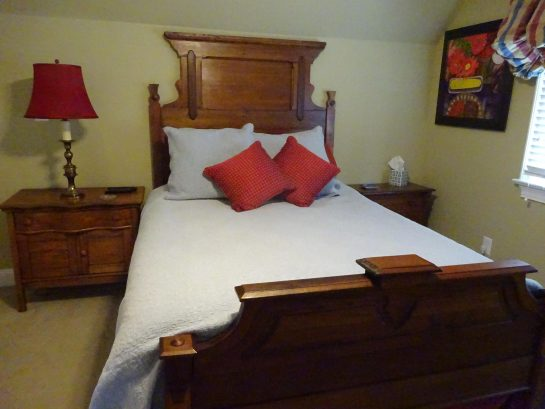 Bedroom 2 - Queen mattress on antique bed, with adjoining bath.