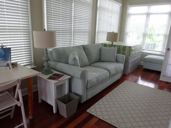 Sunroom adjacent to the living room, perfect for reading a good book.
