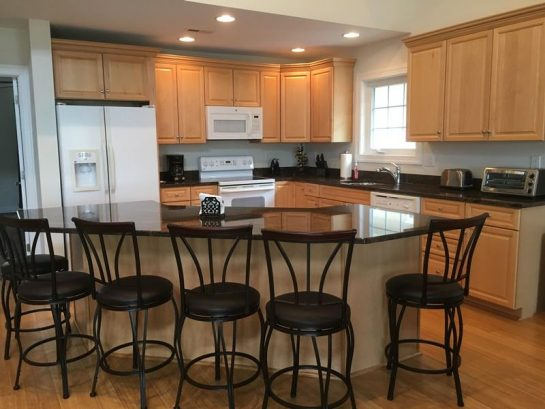 kitchen with 6 stool breakfast bar-granite countertops