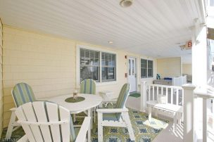 End unit condo with oversized deck area. Pool. One Block to the Beach!
