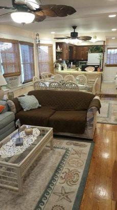 Open Floor Plan; Palm Leaf Ceiling Fans; & Plenty of lighting!