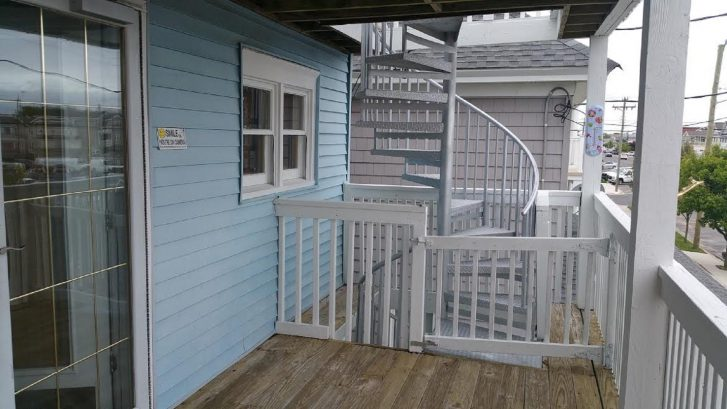 Spiral stairs allow entry from 1st to 2nd floor & Rooftop Deck. New Safety Gate!