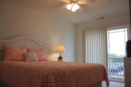 Third floor guest bedroom with balcony.