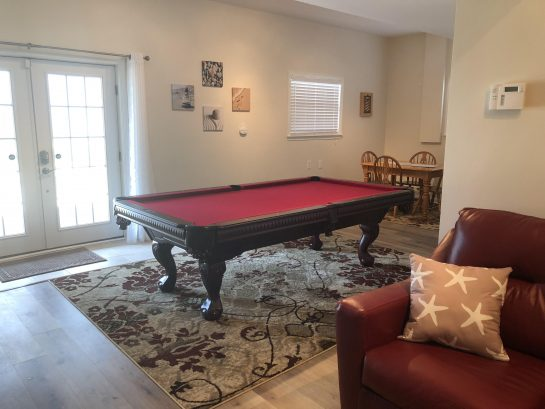 New 8' slate pool table on first floor with game area