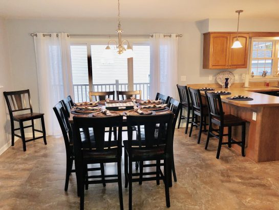 Large fully-stocked eat-in kitchen with seating for 12 guests