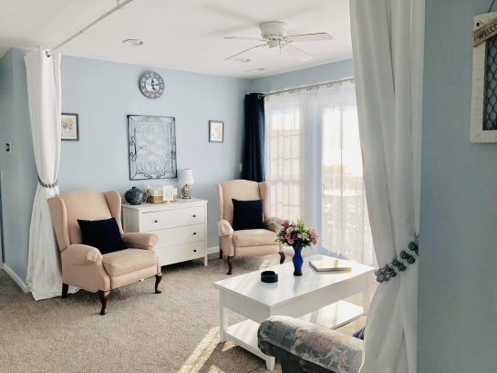 Bedroom #5/sitting room - queen sleeper, dresser, room-dividing drapes, direct deck access and views of beach/bay.