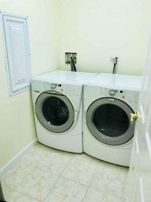 Laundry Room with Front Loader Washer and Dryer