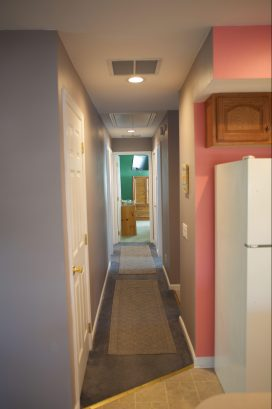 Hallway to bedrooms and bathrooms