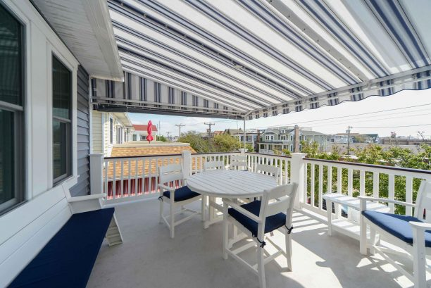Comfortable front deck with canopy awning for enjoying rain or shine