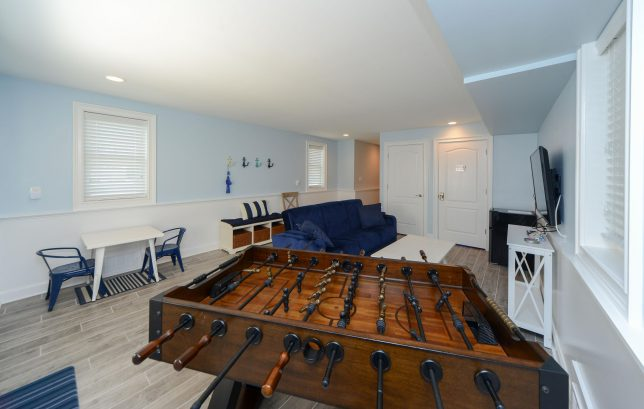 2nd floor entryway recreational room, foosball, TV, stairwell, elevator and garage