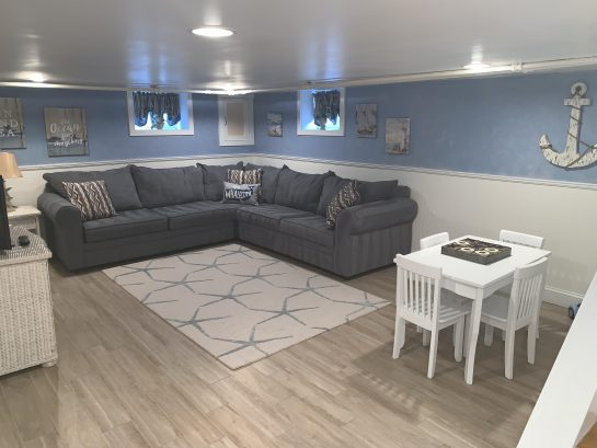 Finished basement with sleeper sofa and kids area