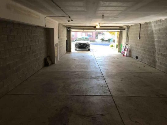 Garage holds 3 intermediate sized cars with room in driveway for 1 car so you could park up to 4 cars on site. Hard to find that anywhere in Wildwood!