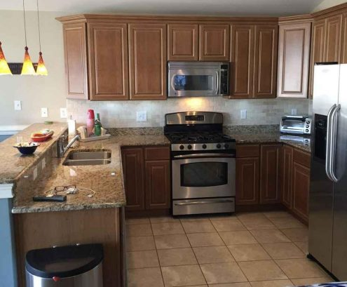 Kitchen w/stainless appliances, granite counters
