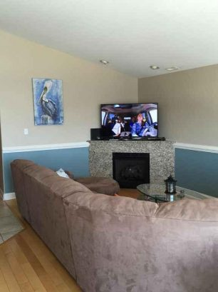 """Great room with 55"""" UHD smart TV, fireplace"""