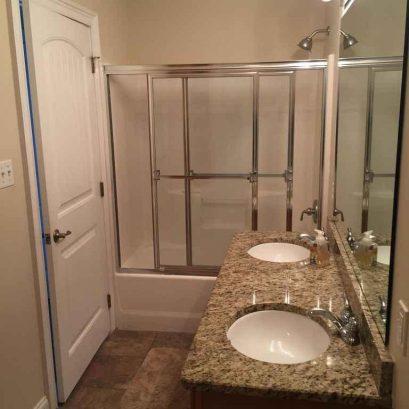 Master bath w/granite double sink, tub/shower combination