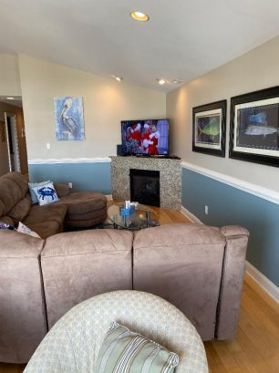 "Sitting area w/55"" UHD smart TV & fireplace & fireplace"