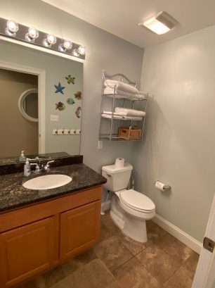 Hall bath w/granite counter, tile floor
