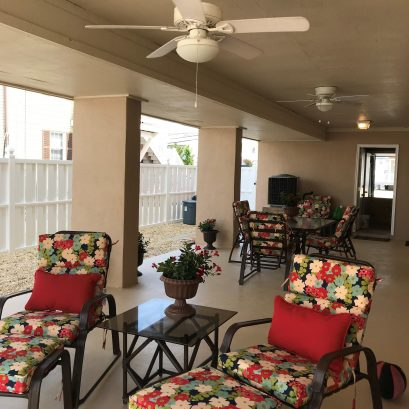 Covered patio with ceiling fans, perfect for after the beach or rainy day activities