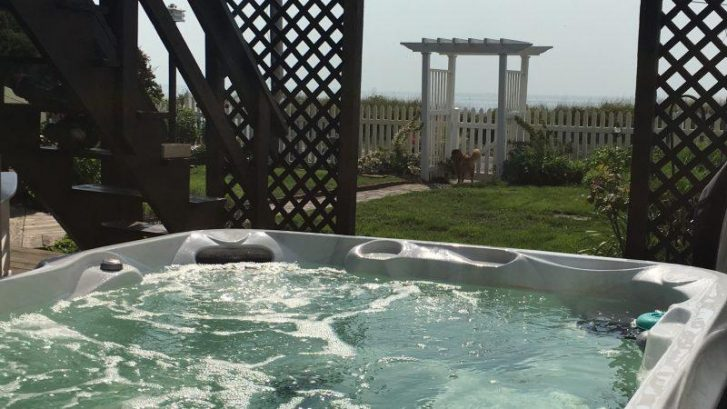 Hot tub overlooking the bay seats 6.