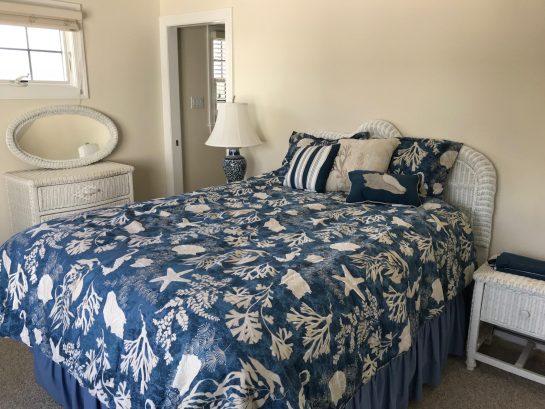 2nd Floor Queen Bedroom suite with private bath overlooking pool.