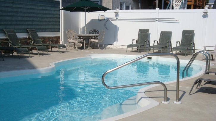 The heated pool and surrounding patio.  Swim, Grill, Eat & Relax!