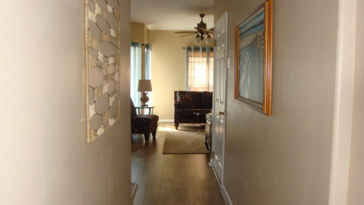 Hallway leading away from bedrooms to living spaces.